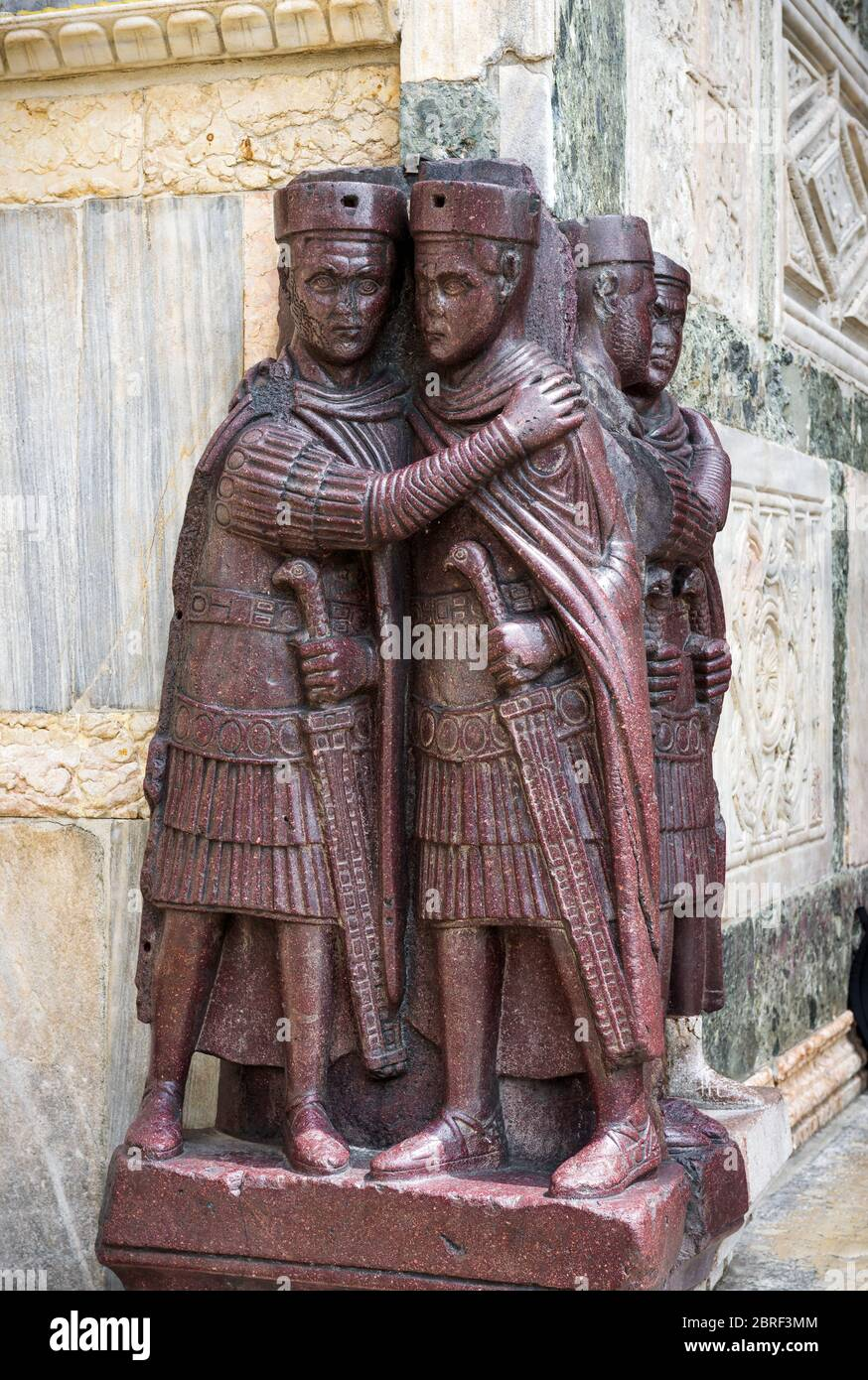 The ancient Portrait of the Four Tetrarchs by the St Mark`s Square in Venice, Italy. It is a porphyry sculpture group of Roman emperors dating from ar Stock Photo
