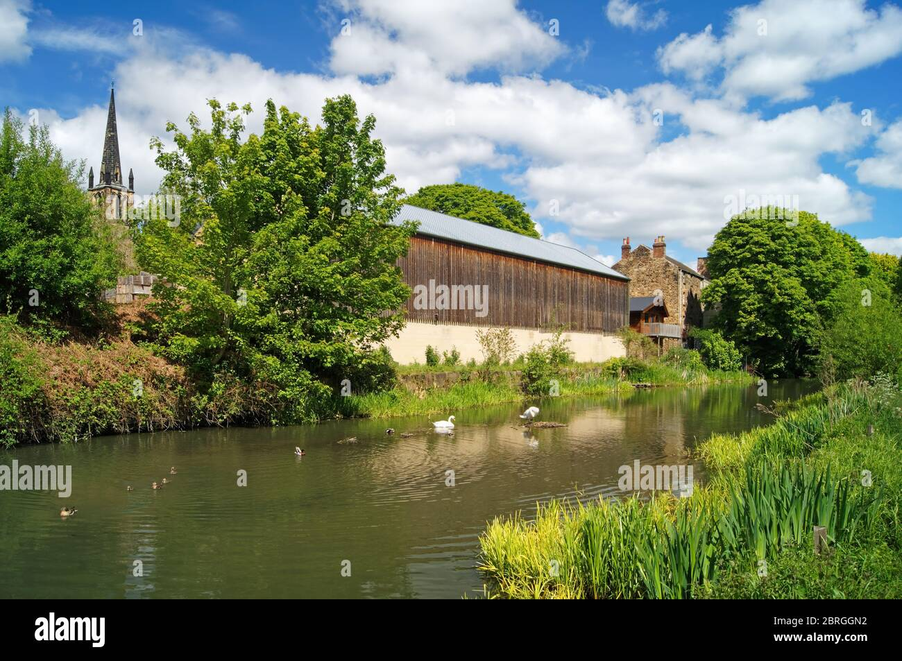 UK,South Yorkshire,Elsecar,Holy Trinity Parish Church and buildings next to Elsecar Canal Stock Photo