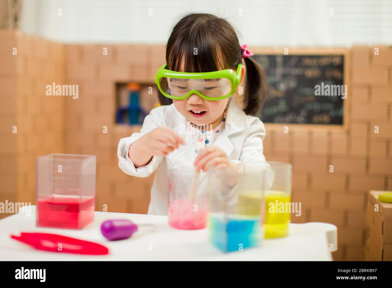 toddler girl pretend play scientist role for homeschooling Stock ...