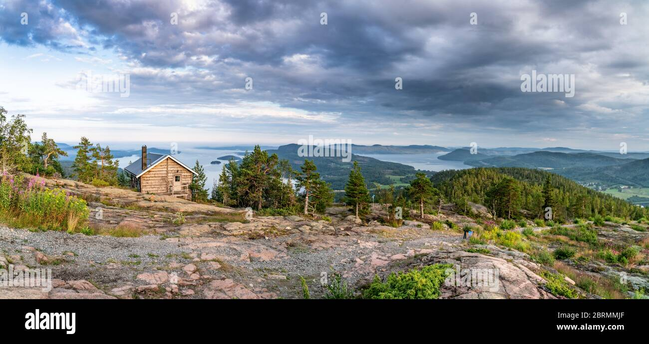 Wide Panorama With Public Tourist Rest House In Front Of View Over Wild Scandinavian Mountains With Pine Tree Forest The Village And Two Sea Bays Su Stock Photo Alamy