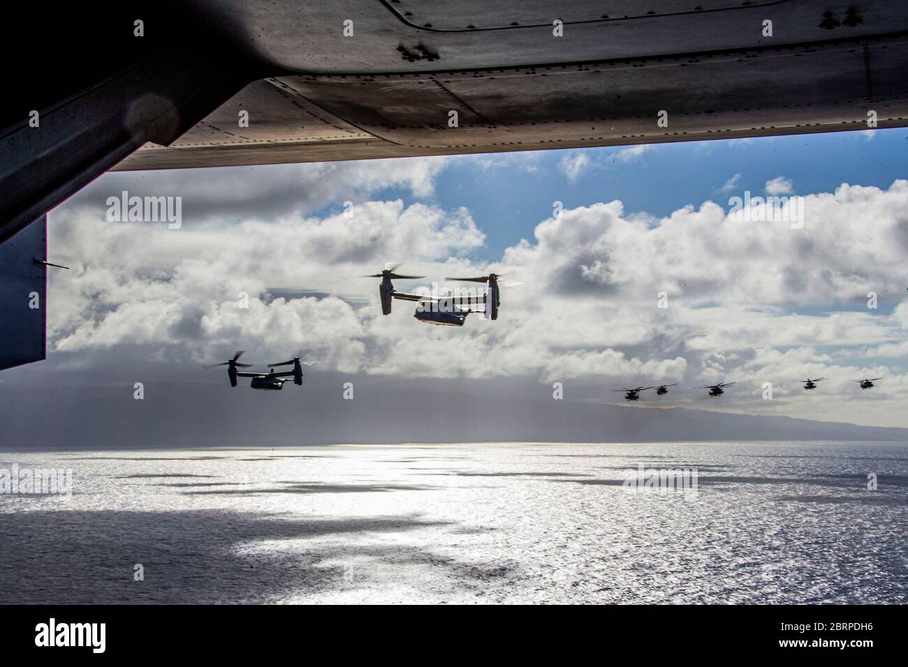 U.S. Marines with Marine Aircraft Group 24 fly over the island of Oahu during an integrated training mission, Marine Corps Air Station Kaneohe Bay, Marine Corps Base Hawaii, May 19, 2020. Utilizing three separate flying platforms, MAG-24 successfully launched seven CH-53E Super Stallions, seven MV-22B Ospreys, and two UH-1Y Venoms while hitting critical training objectives to produce maximum readiness. (U.S. Marine Corps photo by Lance Cpl. Jacob Wilson) Stock Photo
