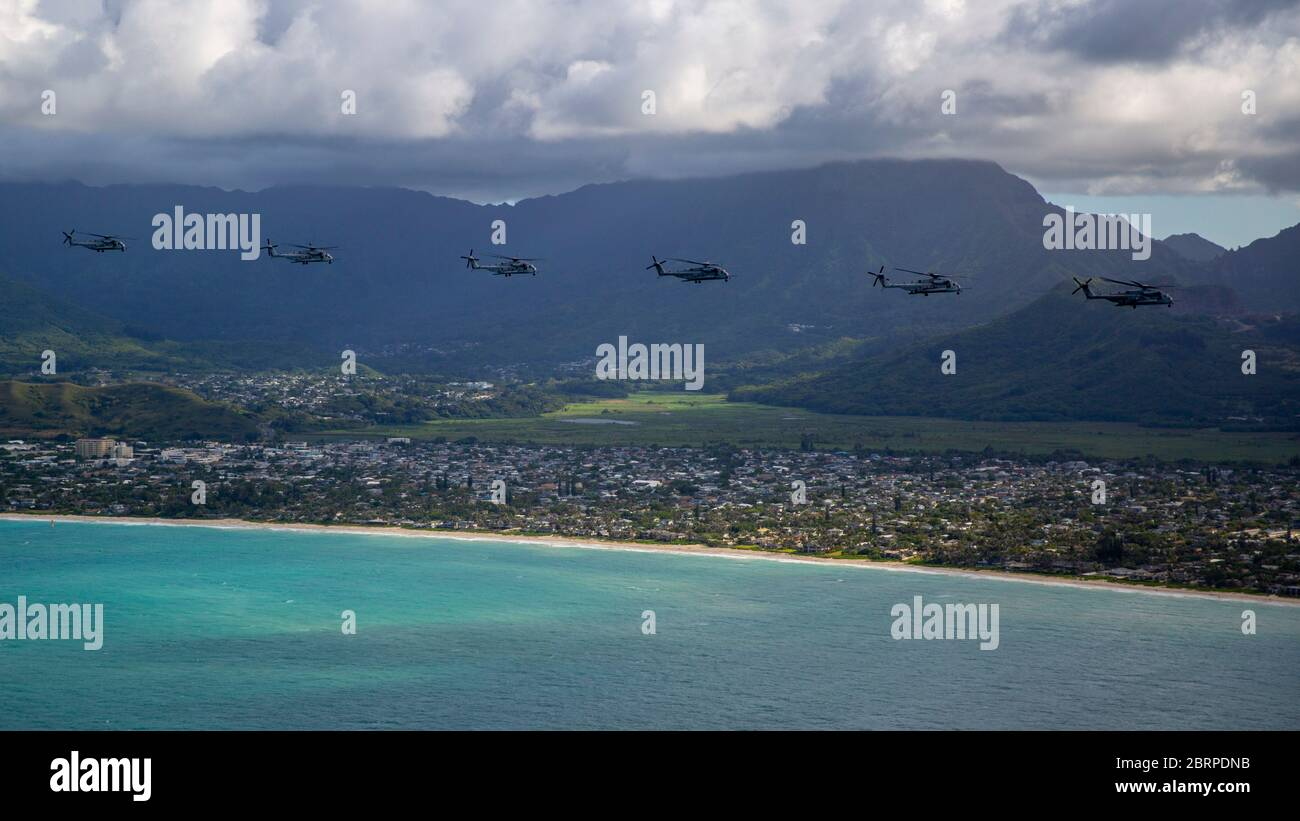 U.S. Marines with Marine Aircraft Group 24, conducted an integrated training mission along the shores of Oahu from Marine Corps Air Station Kaneohe Bay, Marine Corps Base Hawaii, May 19, 2020. Utilizing three separate flying platforms, MAG-24 successfully launched seven CH-53E Super Stallions, seven MV-22B Ospreys, and two UH-1Y Venoms while hitting critical training objectives to produce maximum readiness. (U.S. Marine Corps photo by Cpl. Eric Tso) Stock Photo