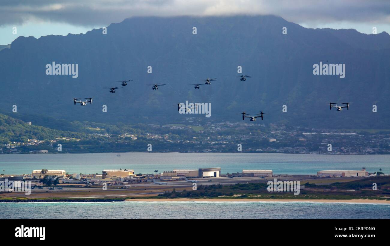 U.S. Marines with Marine Aircraft Group 24, conducted integrated training mission along the shores of Oahu from Marine Corps Air Station Kaneohe Bay, Marine Corps Base Hawaii, May 19, 2020. Utilizing three separate flying platforms, MAG-24 successfully launched seven CH-53E Super Stallions, seven MV-22B Ospreys, and two UH-1Y Venoms while hitting critical training objectives to produce maximum readiness. (U.S. Marine Corps photo by Cpl. Eric Tso) Stock Photo