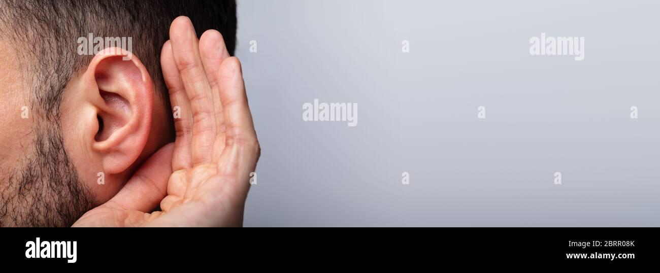 Person Trying Hear Aid. Ear Damage. Deaf Stock Photo