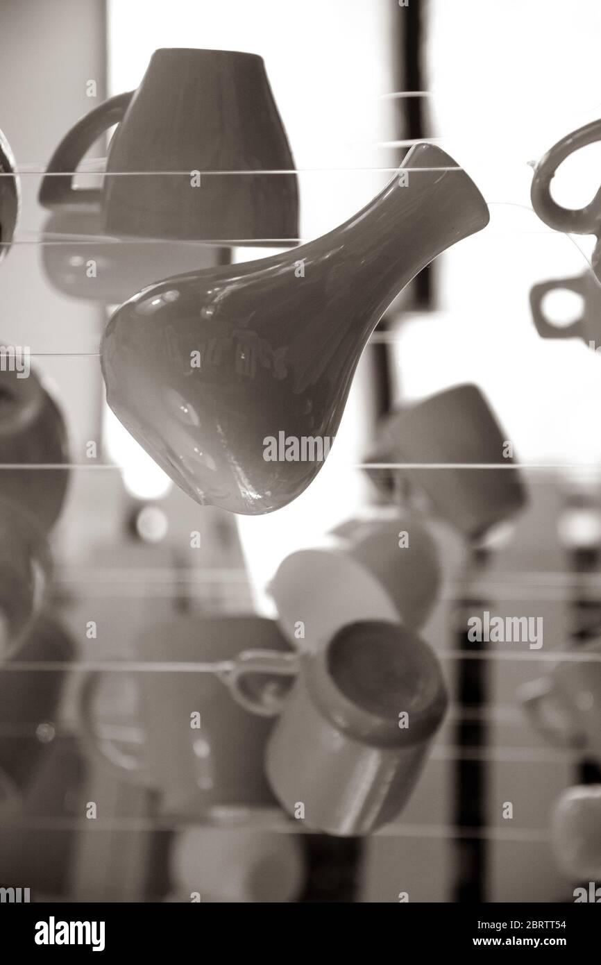 Sepia Monochrome Photography Of Kitchen Utensil Silhouettes Ceramic Vase Coffee Cups And Tea Mugs Are Hanging On Strings Stock Photo Alamy