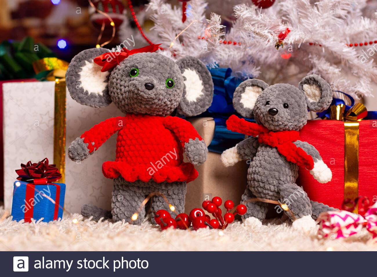Two homemade plush mice under the Christmas tree with gifts Stock Photo