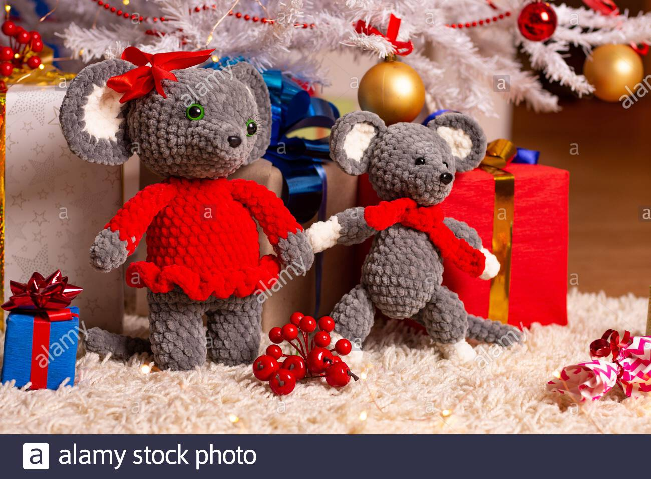 Two funny plush mice under the Christmas tree Stock Photo
