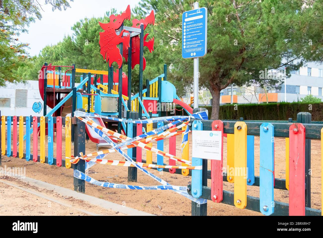 Huelva, Spain - May 5, 2020: Empty and closed children playground at sunset due to the alarm state and quarantine in Spain for the epidemic period of Stock Photo