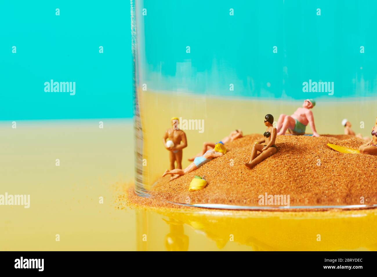 Some Miniature People Wearing Swimsuit Relaxing On The Sand In A Bell Jar Symbolizing Different Ideas Such As The Greenhouse Effect Or The Protectio Stock Photo Alamy
