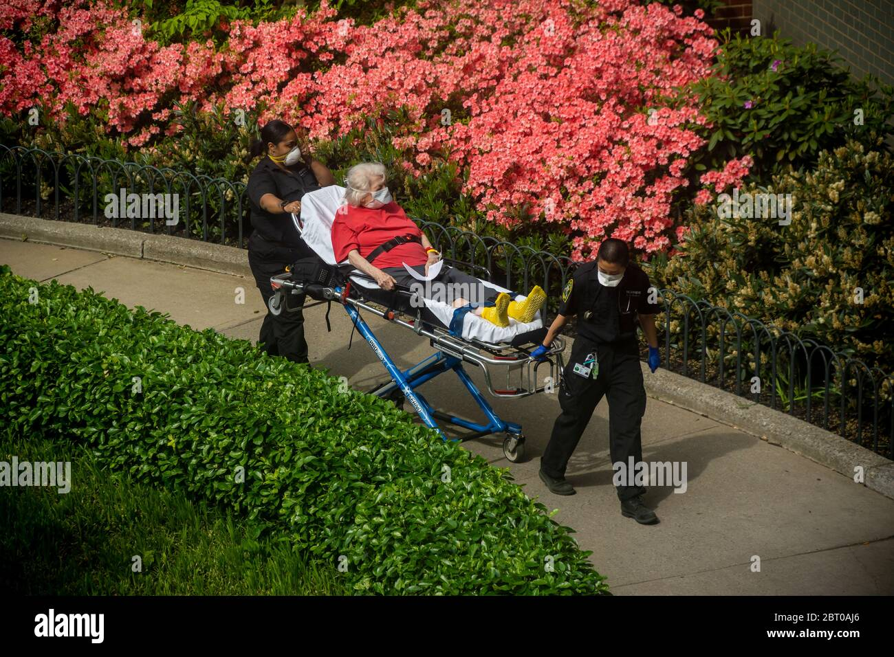 EMT's transport an elderly woman back home  in the Chelsea neighborhood of New York on Monday, May 18, 2020. (© Richard B. Levine) Stock Photo