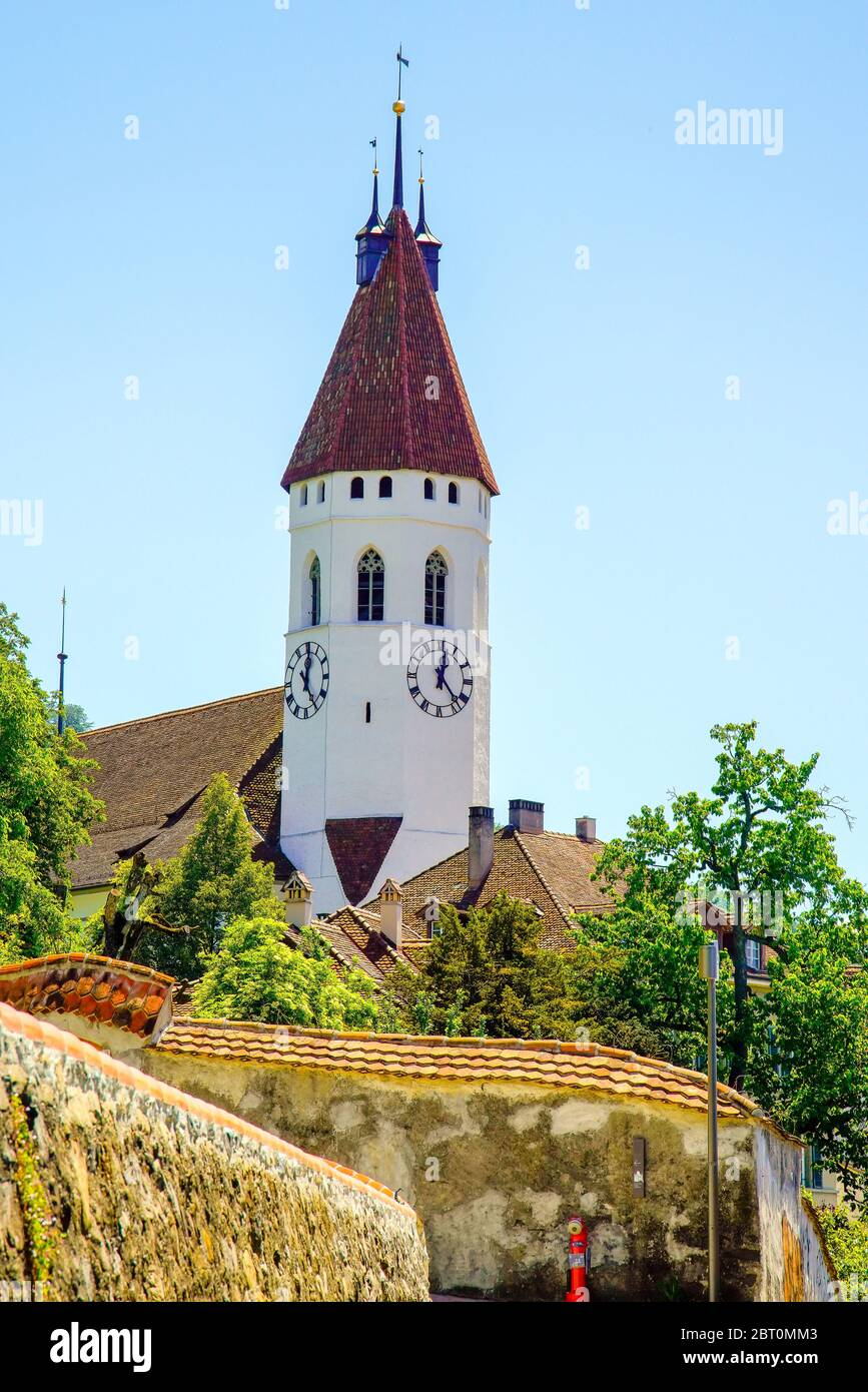 The impressive octagonal front tower of the Stadtkirche Thun dates back to around 1330. Thun, Bern canton, Switzerland. Stock Photo