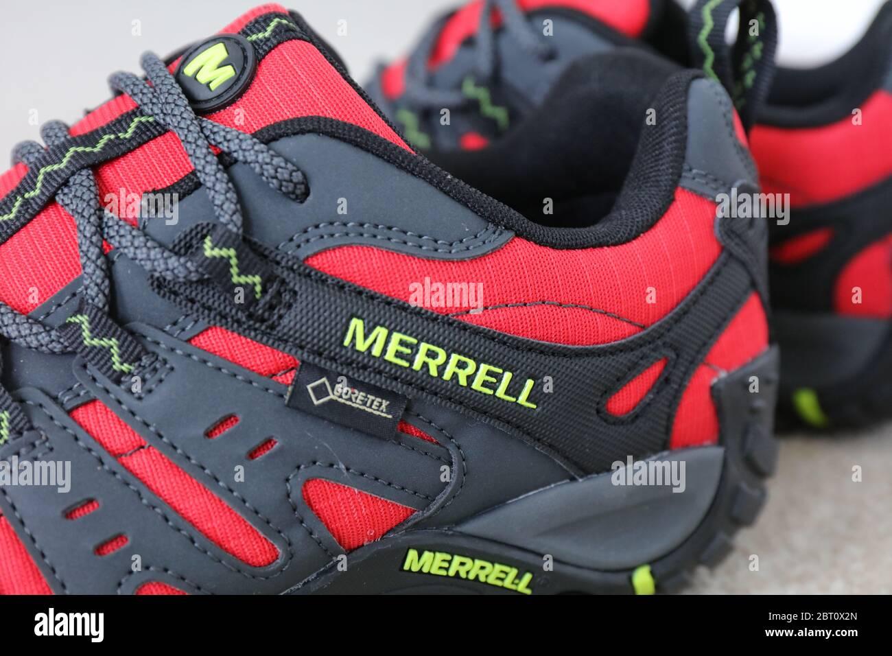 A Pair of a Merrell Red Accentor Sport