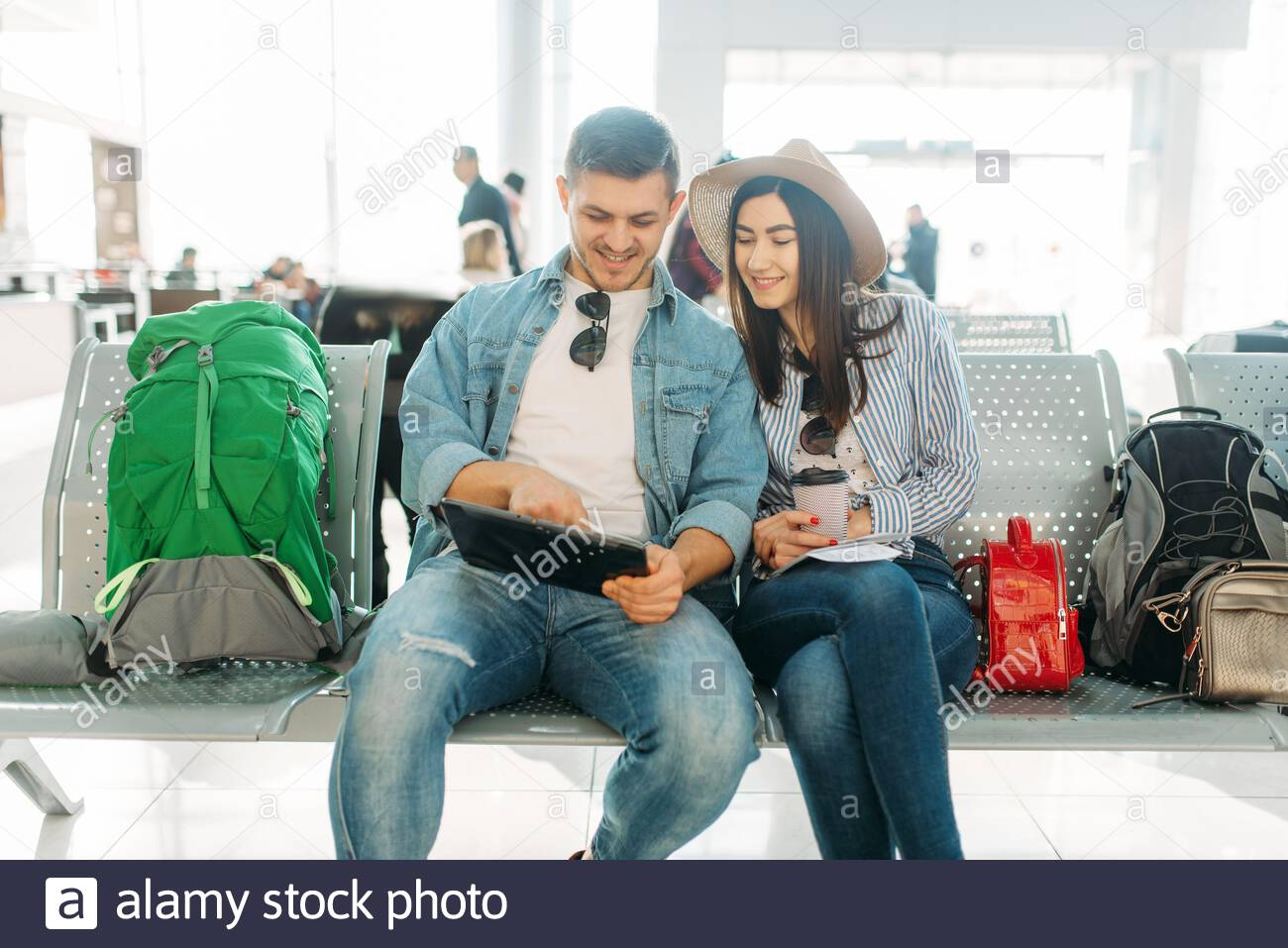 Love Couple With Luggage Waiting For Departure In Airport Passengers With Baggage In Air Terminal Happy Journey Summer Travel Stock Photo Alamy