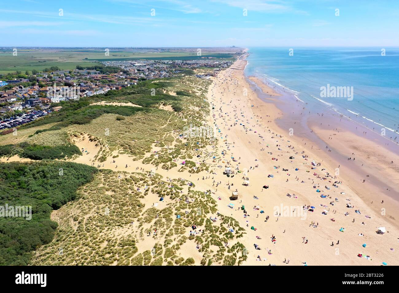 worlds most beautiful beaches, camber sands on a beautiful sunny day packed with beach lovers Stock Photo