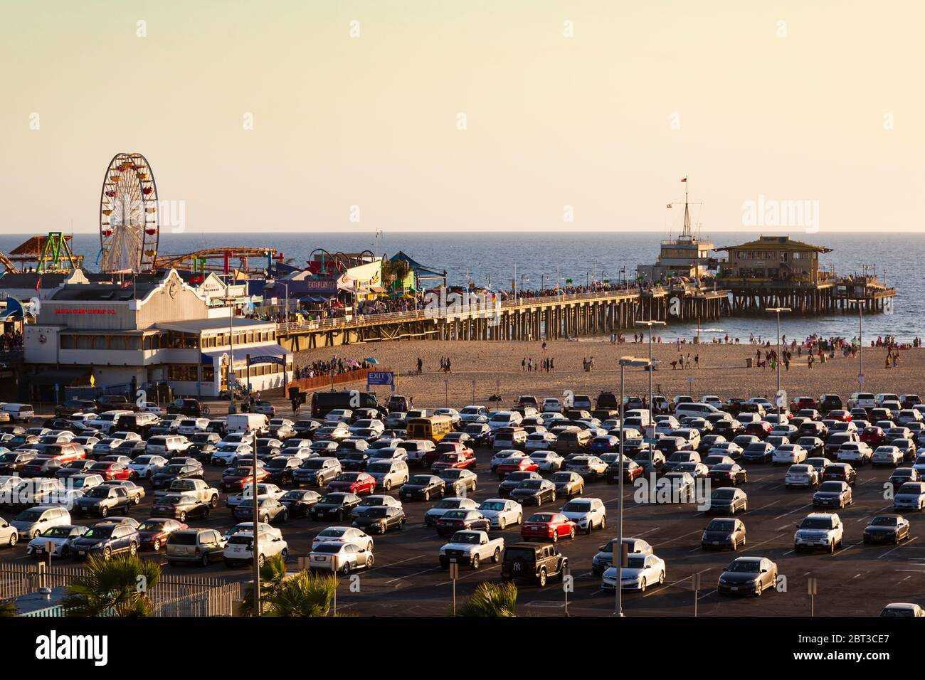 Parking lot and cars at sundown, Santa Monica pier and beach, Los Angeles, California, United States of America. Stock Photo