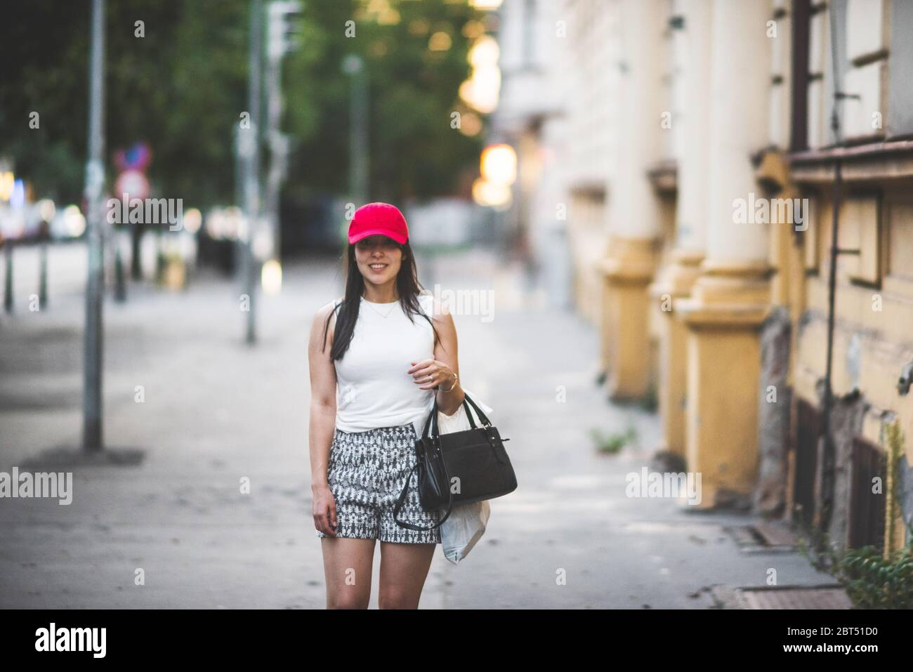 Smiling woman standing in street, Prague, Czech Republic Stock Photo