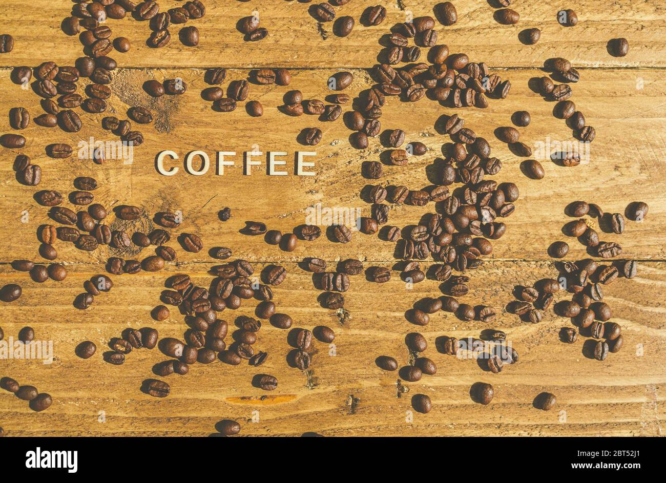Roasted coffee beans with the word coffee Stock Photo