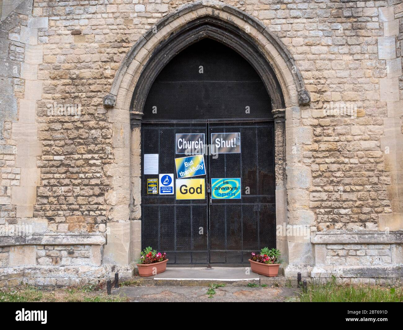 Willingham Cambridgeshire, UK. 23rd May, 2020. The church remains closed with signs on the shut door announcing that the church is closed but God is always open due to the coronavirus or covid-19 pandemic. President Trump has called for churches in USA to be reopened and they remain closed in the UK. Credit: Julian Eales/Alamy Live News Stock Photo