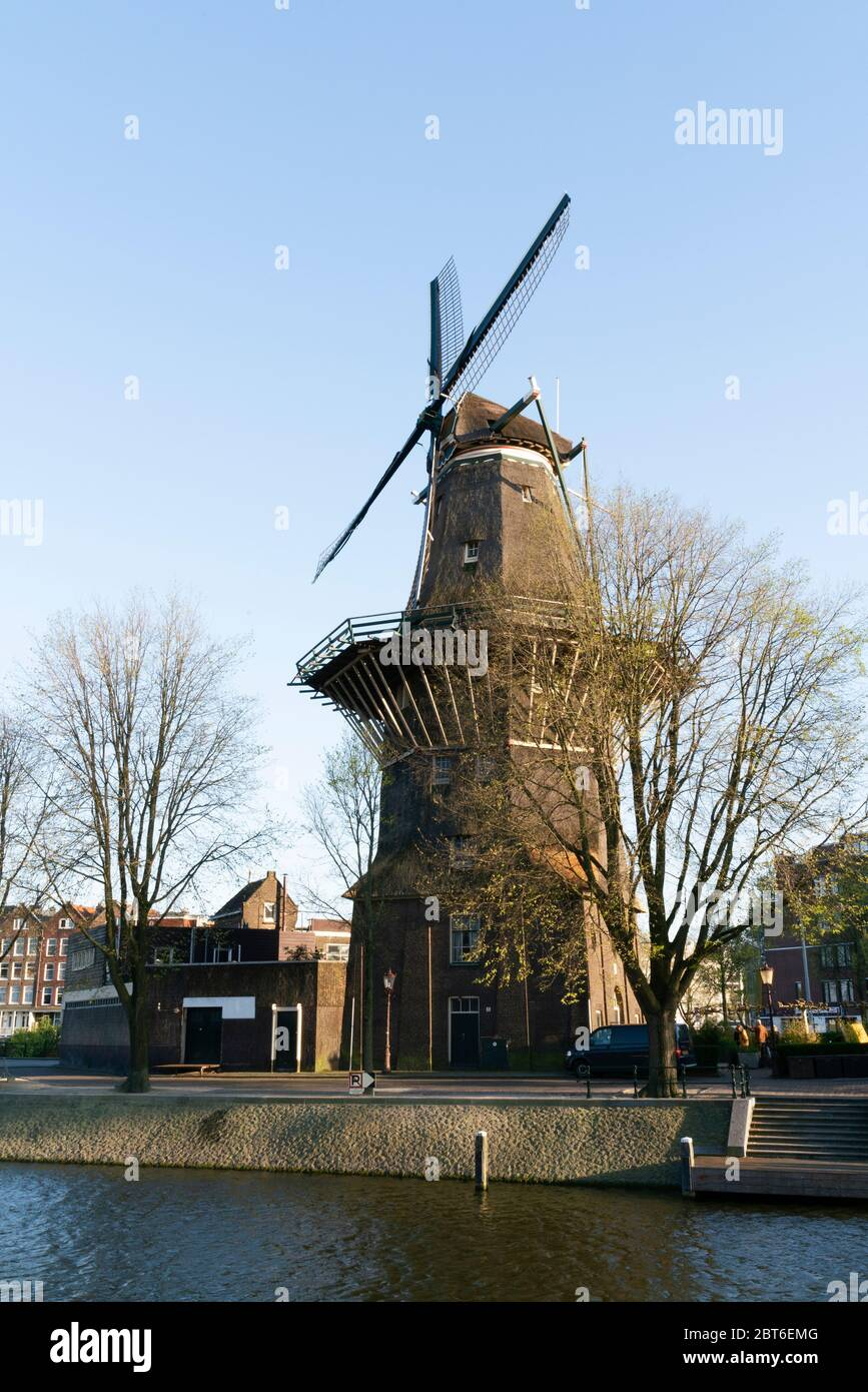 View of famous historical De Gooyer Windmill on a sunny day in Amsterdam Stock Photo
