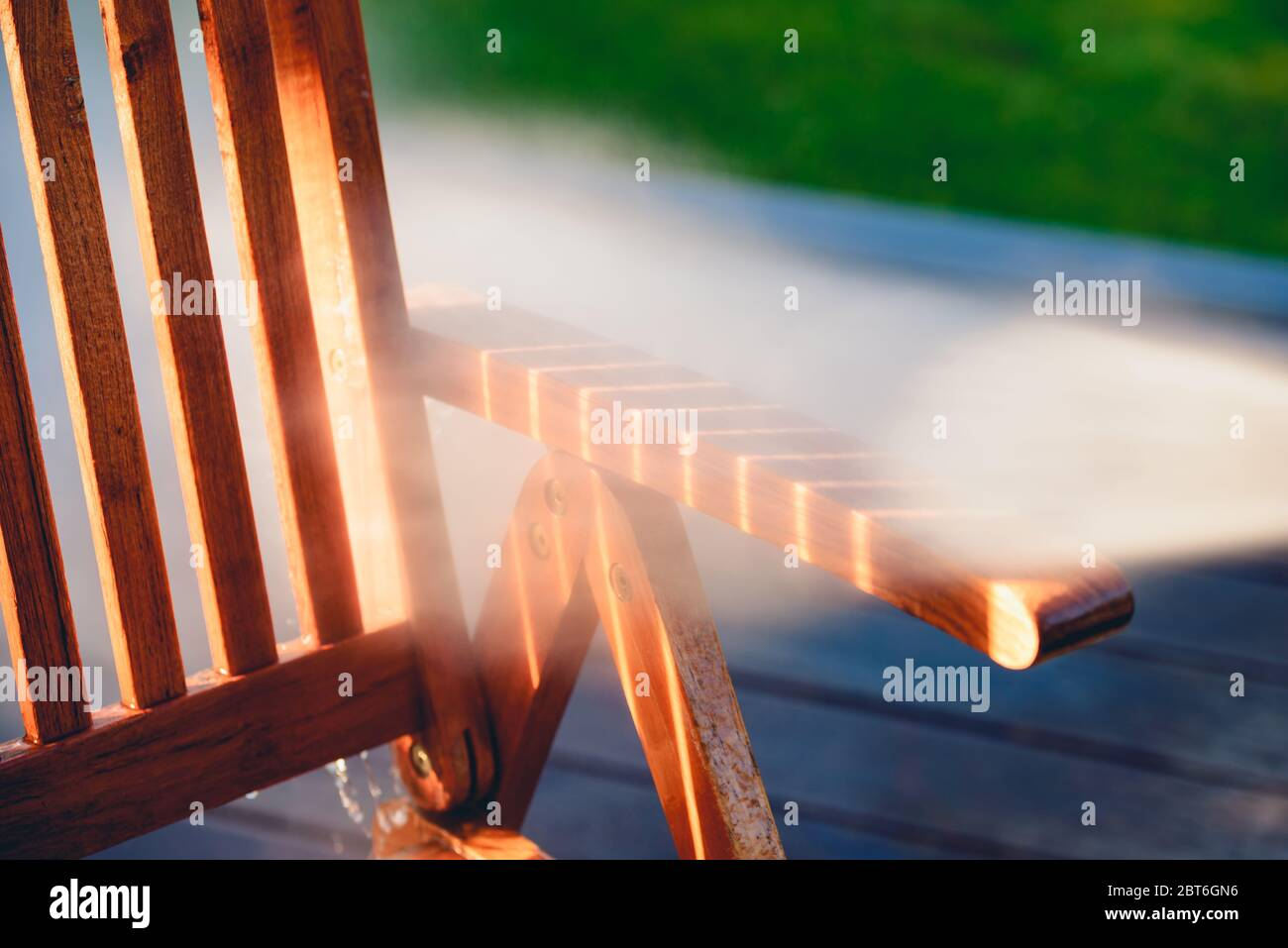 power washing garden furniture - made of exotic wood - very shallow depth of field Stock Photo