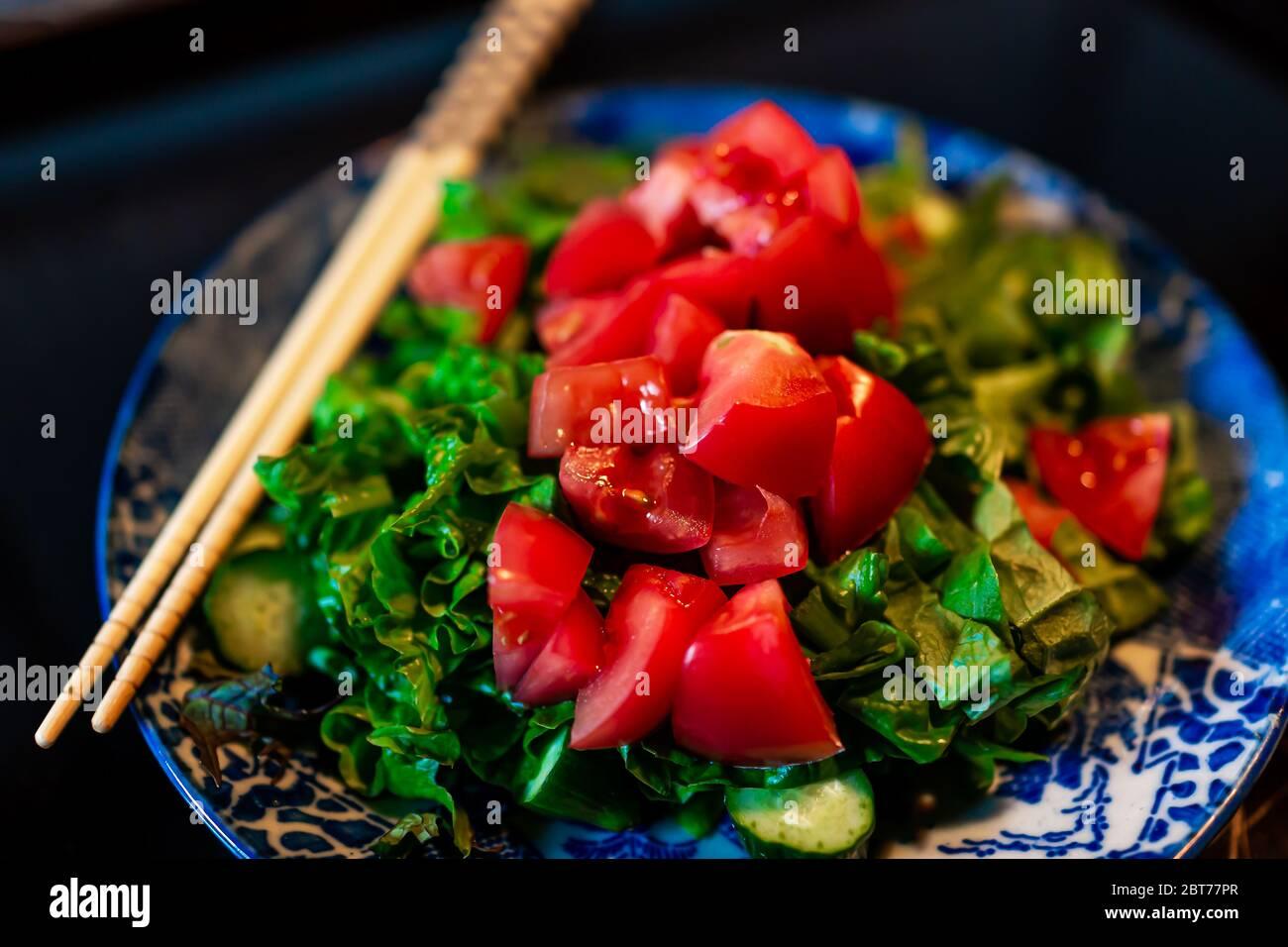Colorful chopped vegetables salad macro closeup with raw vegan ...