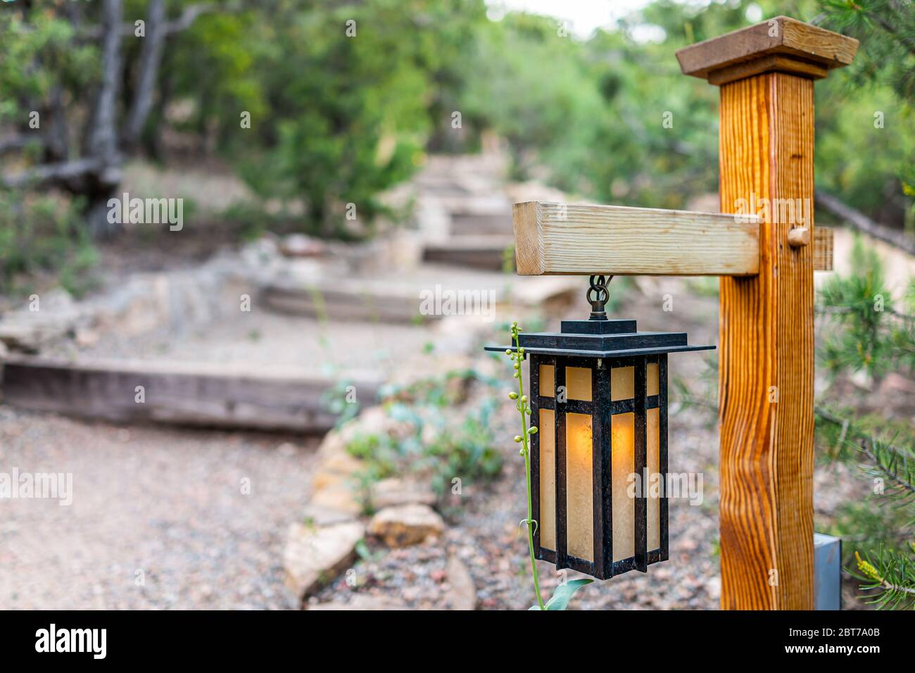 Japan In Evening With Illuminated Hanging Lantern Lamp Light On Wooden Pole Post In Japanese Garden With Steps Stairs And Green Trees Foliage In Blurr Stock Photo Alamy