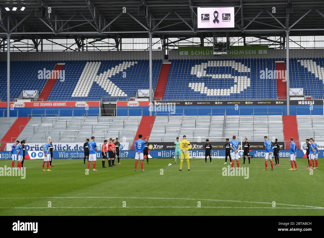 Kiel Germany 24th May 2020 Football 2nd Bundesliga Holstein Kiel Vfb Stuttgart 27th Matchday At The Holstein Stadium The Players Of Both Teams Will Stand On The Pitch During A Minute S