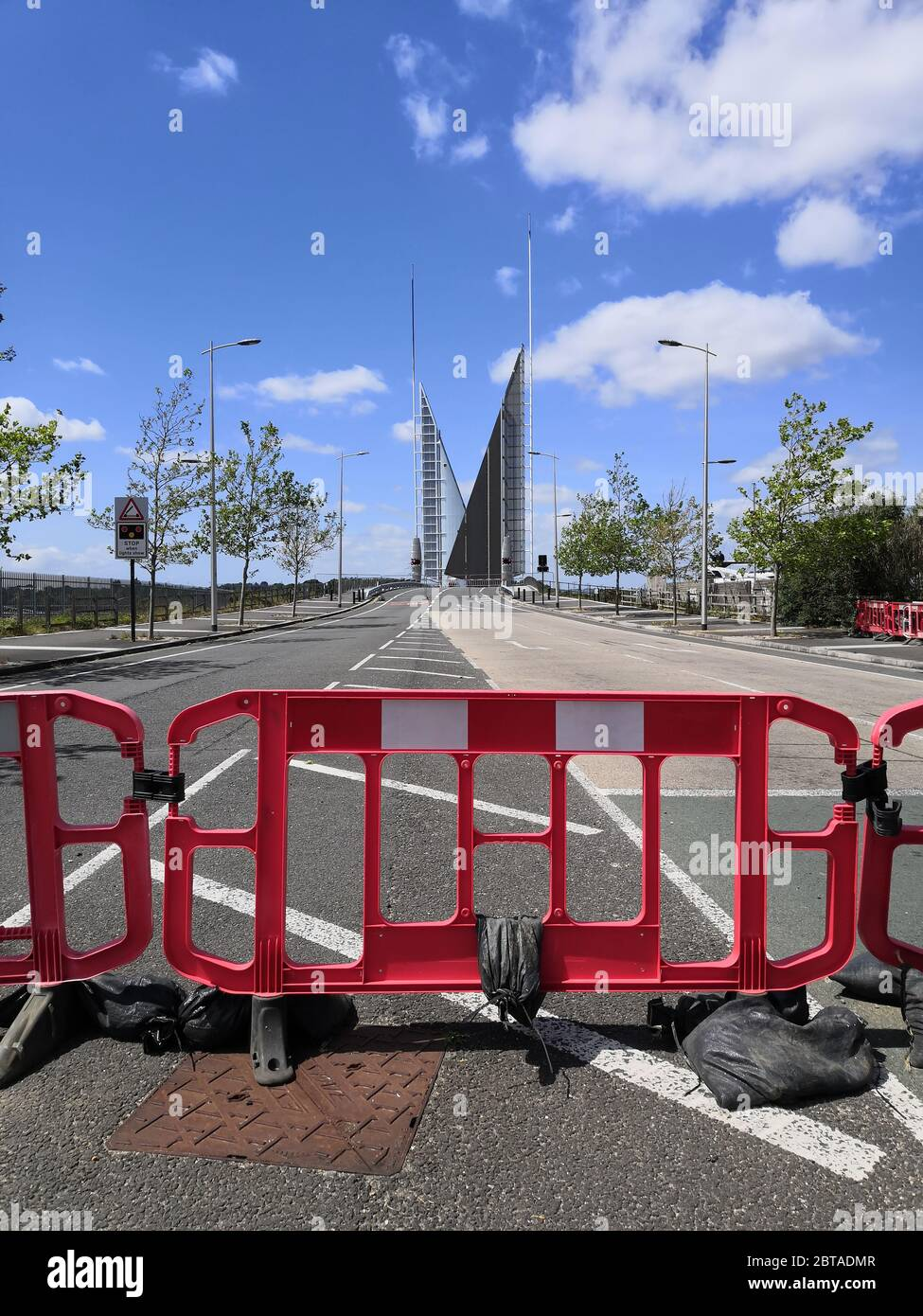 Poole, UK. 24th May, 2020. Poole, UK. Sunday 24 May 2020. The Poole Twin Sails bridge is stuck in the open position as it awaits repairs. It is currently closed to traffic and pedestrians. Credit: Thomas Faull/Alamy Live News Stock Photo