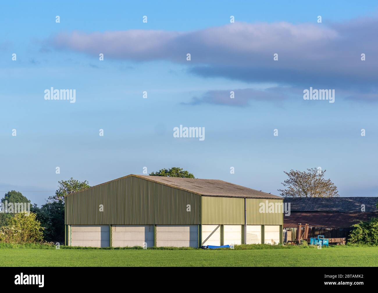 Prefabricated Farm Building In A Rural Setting On A Sunny Day With Blue Sky Stock Photo Alamy