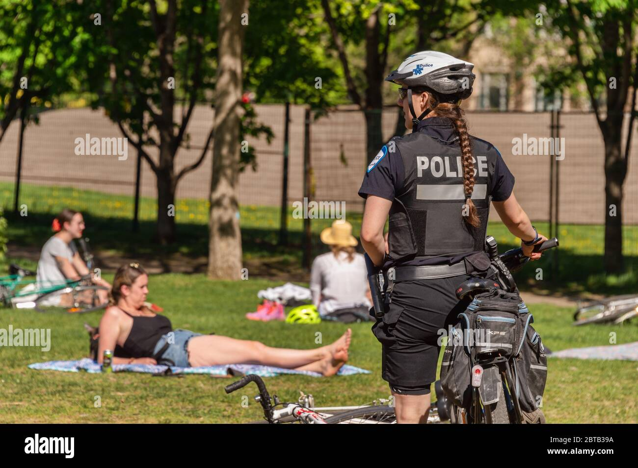 Montreal, Canada - 23 May 2020: Police patrol Laurier park to enforce the coronavirus physical-distancing laws Stock Photo