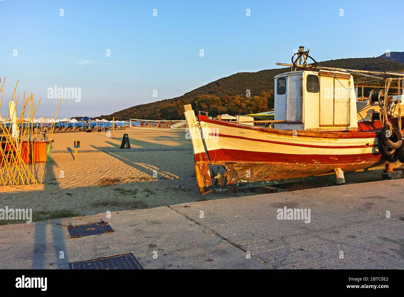 STAVROS, GREECE - AUGUST 19, 2019:  Sunset at coastline of village of Stavros, Chalkidiki, Central Macedonia, Greece Stock Photo