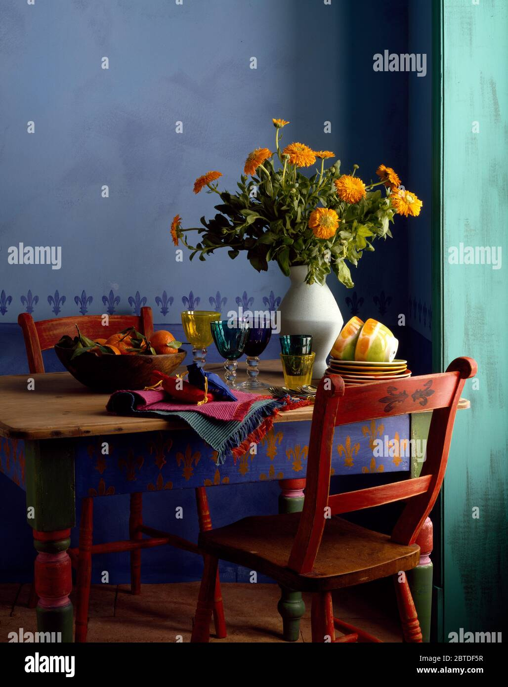 Painted Vintage Table And Chair In Blue Economy Dining Room Stock Photo Alamy