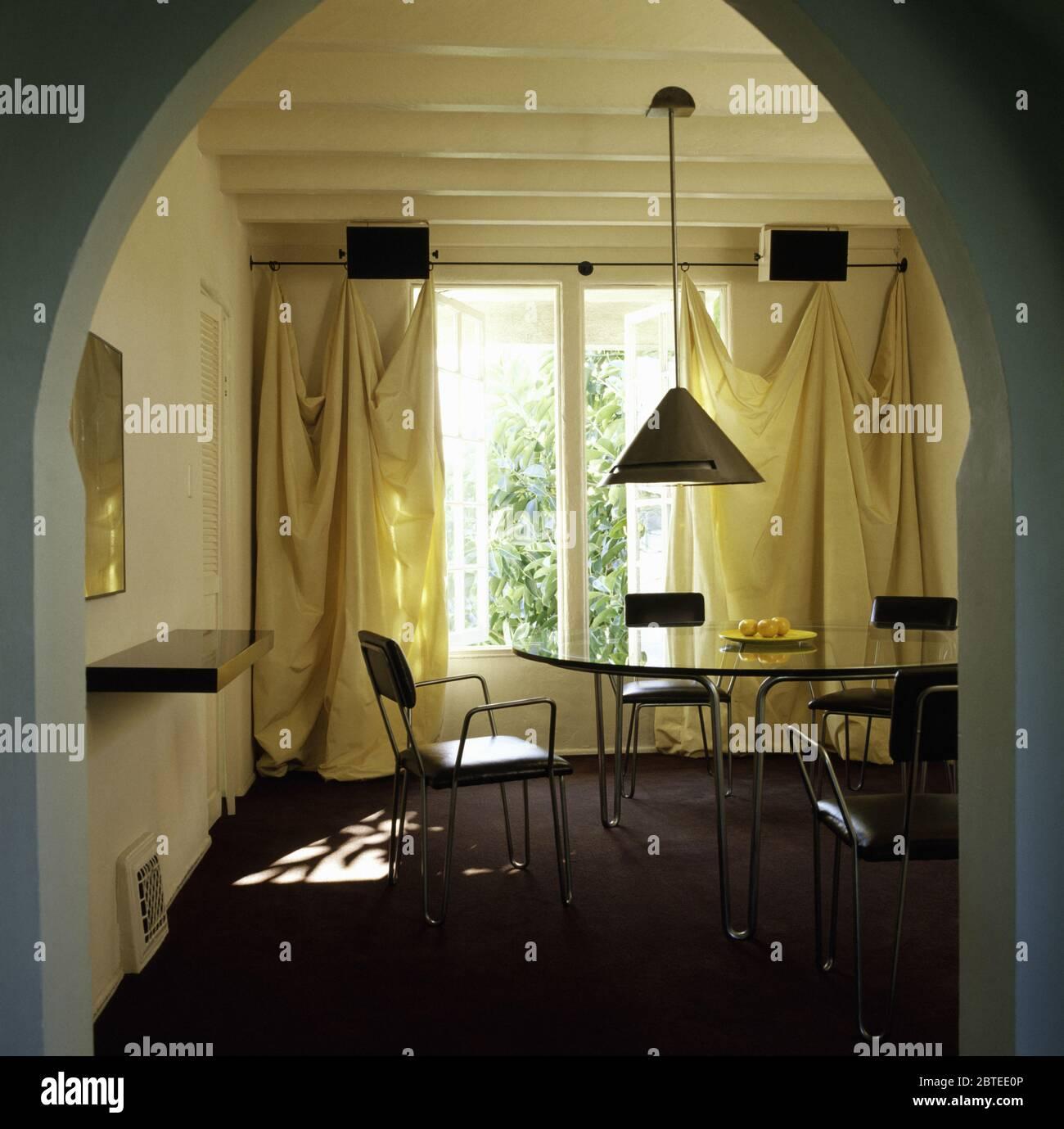 Yellow Silk Drapes In Eighties Dining Room Stock Photo Alamy
