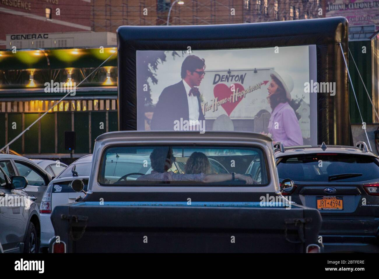 A Couple Seen Watching The Rocky Horror Picture Showing In An Improvised Drive In Movie Theatre