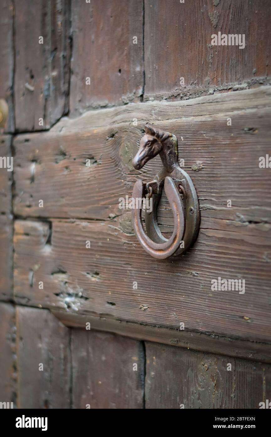 Decorative Door Knocker With Horse Head And Horseshoe Close Up Stock Photo Alamy