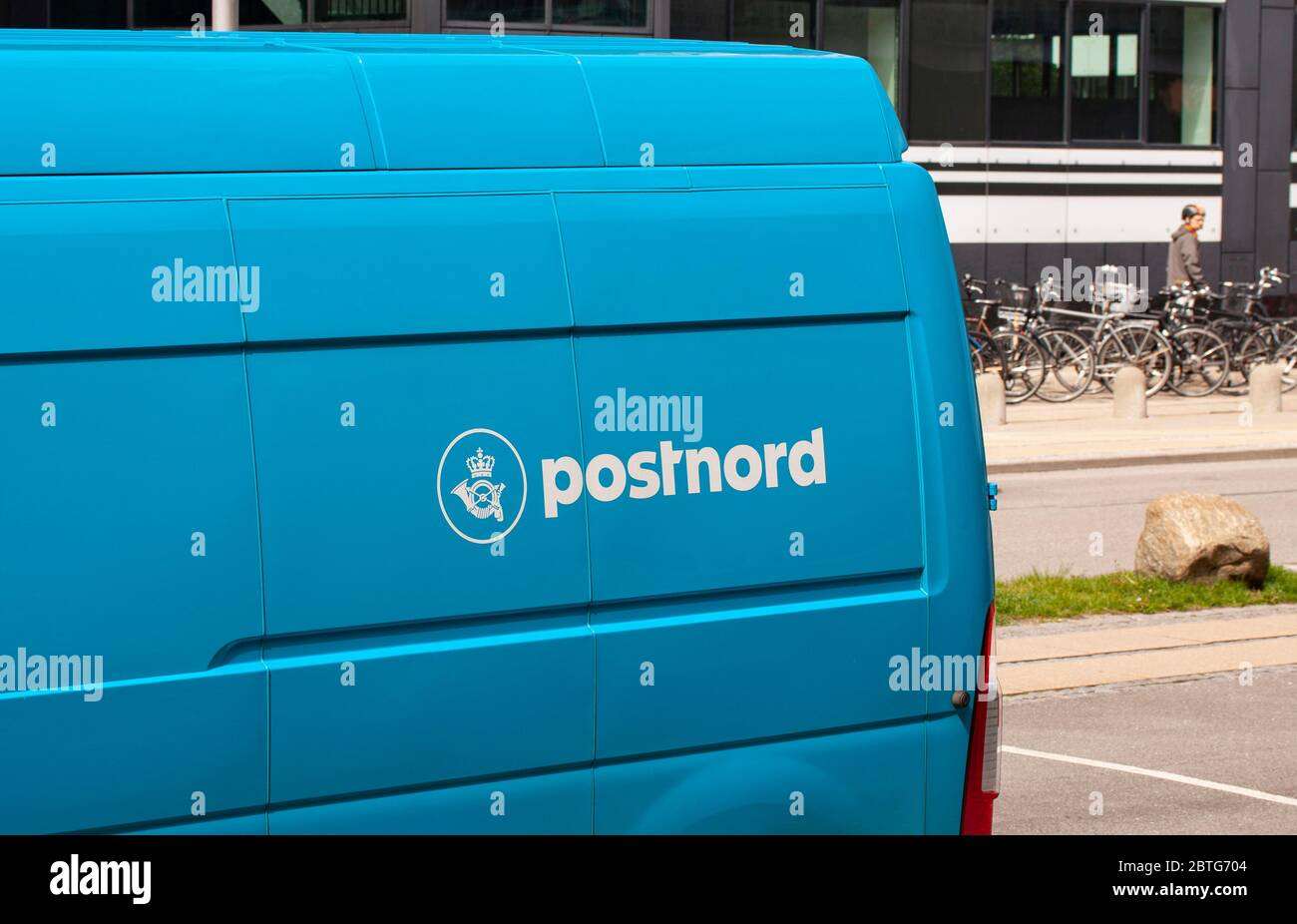 Blue van with Postnord logotype. PostNord AB is the name of the holding company of the two merged postal companies Posten AB Sweden and Post Danmark. Stock Photo