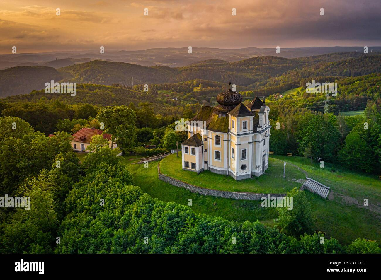 Poppy Mountain is a peak in the Benesov Hills and an important place of pilgrimage. Baroque church of St. John the Baptist and the Virgin Mary. Stock Photo