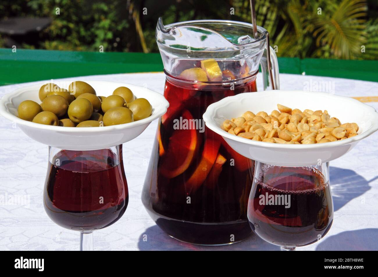 Jug and glasses of freshly made Spanish Sangria with nibbles/tapas ...