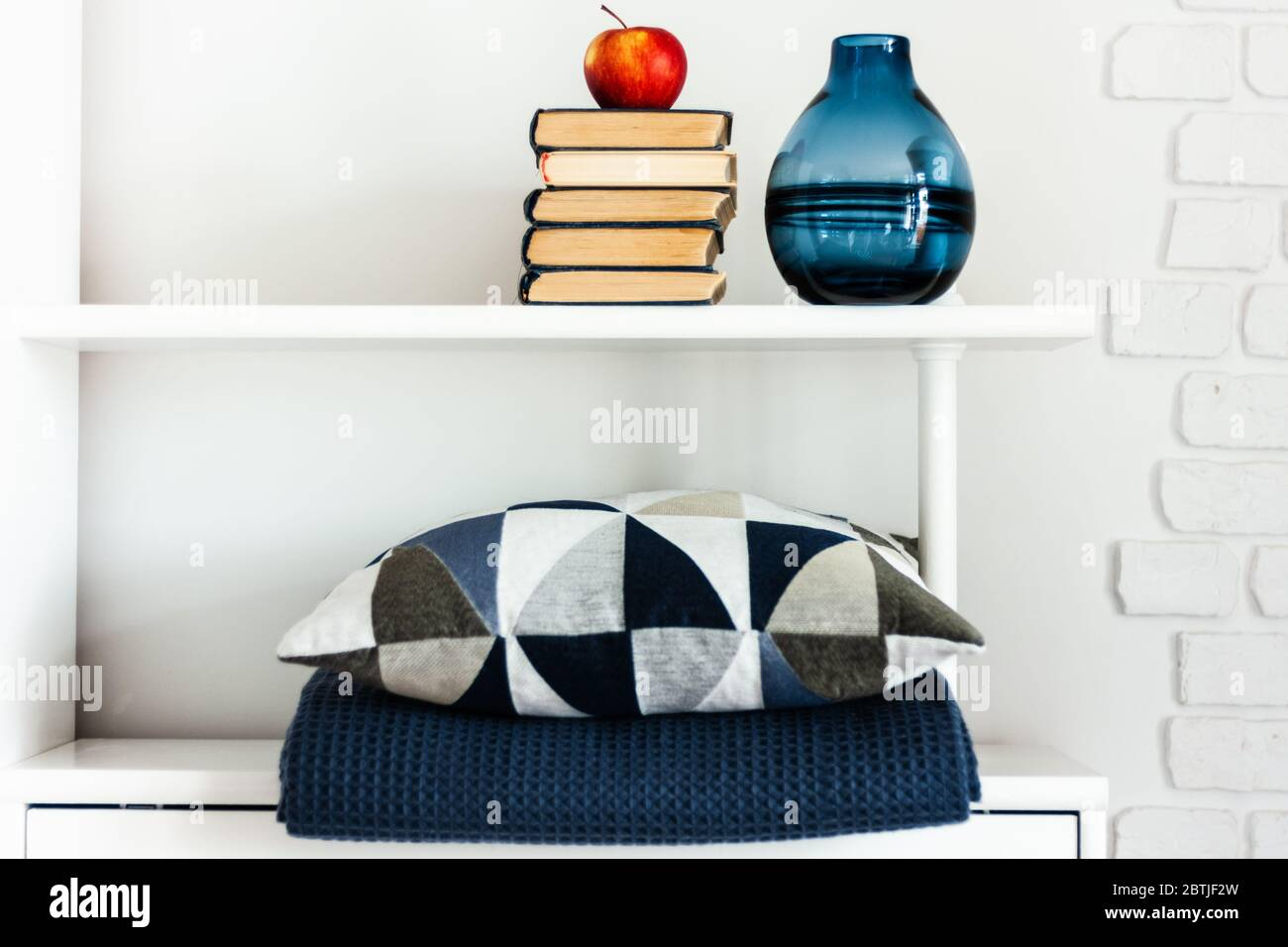 Cozy Home Interior Decor Pillow Plaid Blue Vase Stack Of Books Red Apple On A White Shelf In The Room The Quarantine Concept Of Stay Home Dista Stock Photo Alamy
