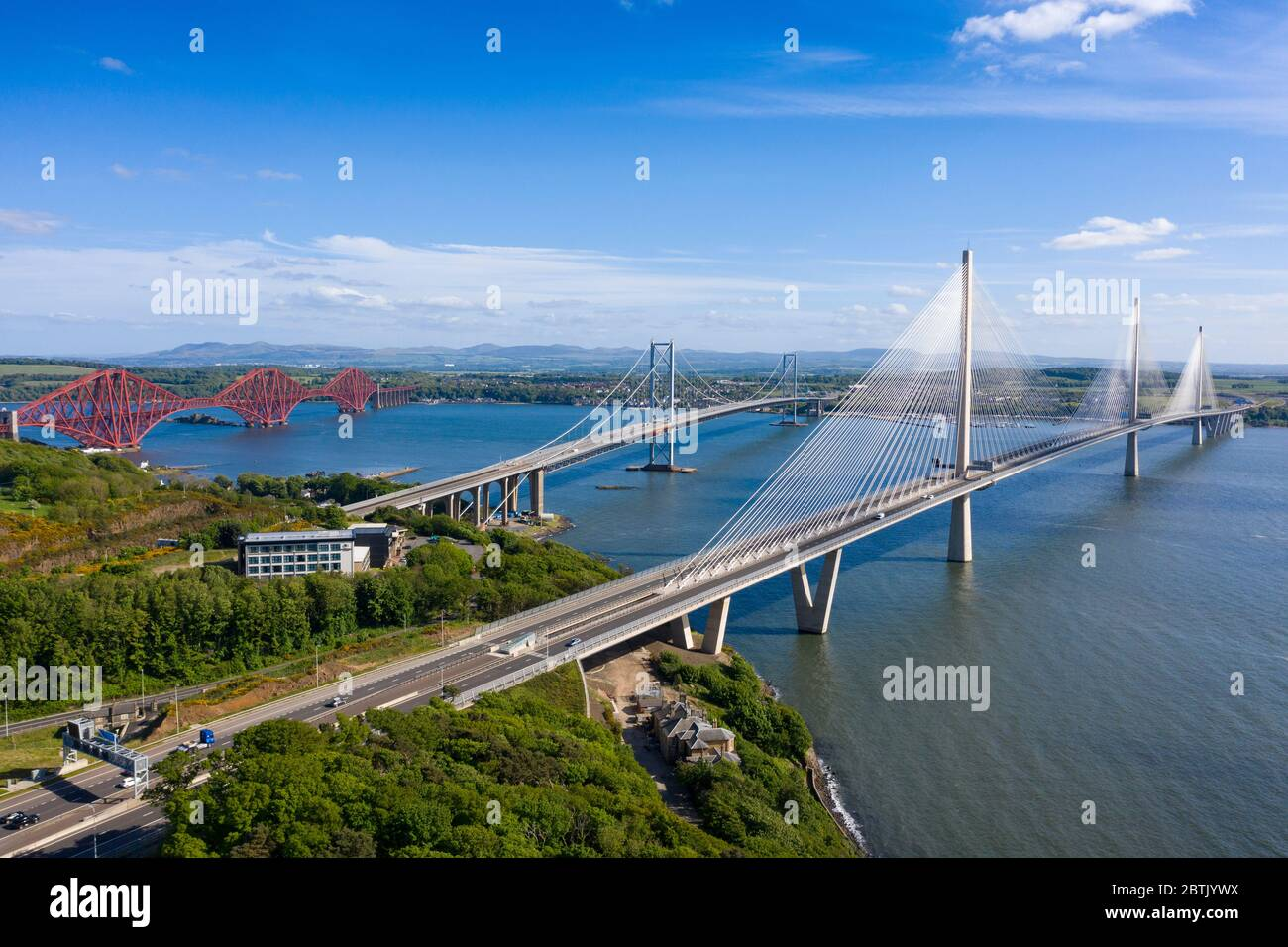 Aerial view of three bridges crossing the River Forth with new Queensferry Crossing in front at North Queensferry, Fife, Scotland, UK Stock Photo