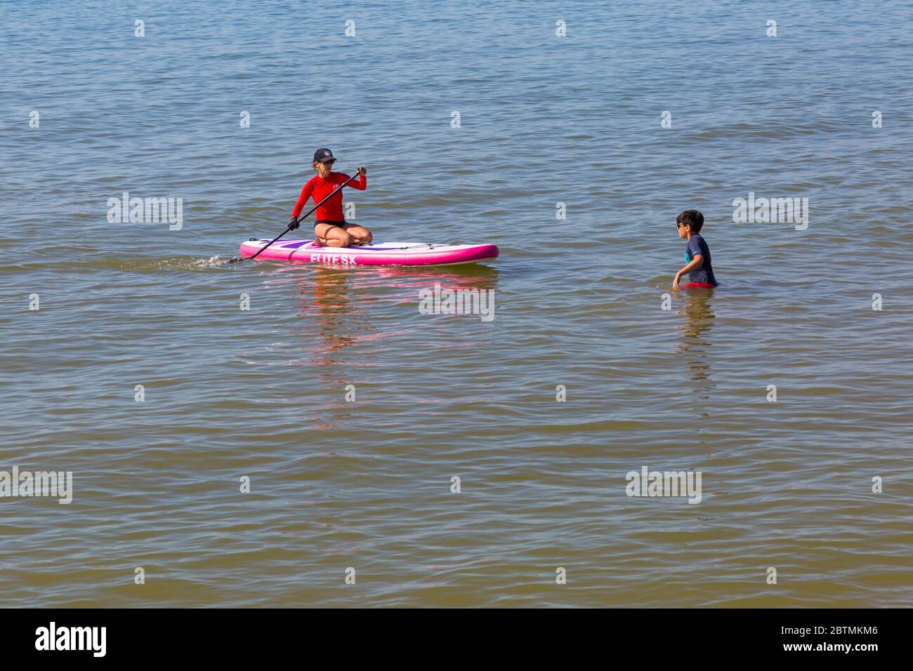 Poole, Dorset UK. 27th May 2020. UK weather: another hot sunny day at Poole beaches with clear blue skies and unbroken sunshine, as the glorious weather continues and temperatures rise. Sunseekers head to the seaside to enjoy the sunshine. Credit: Carolyn Jenkins/Alamy Live News Stock Photo