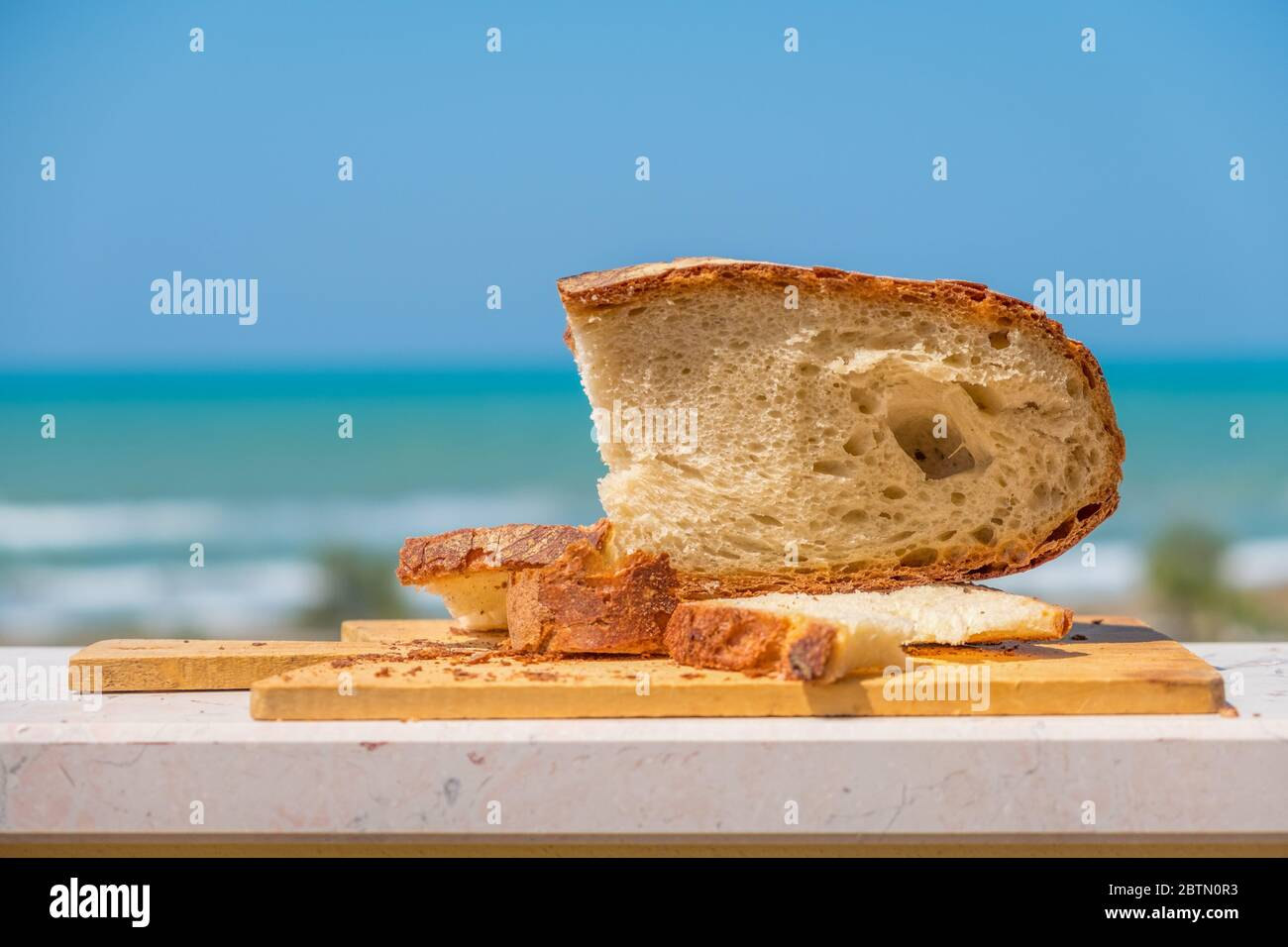 bakery shop background with Pane Pugliese, a traditional bread of South Italy food tradition Stock Photo
