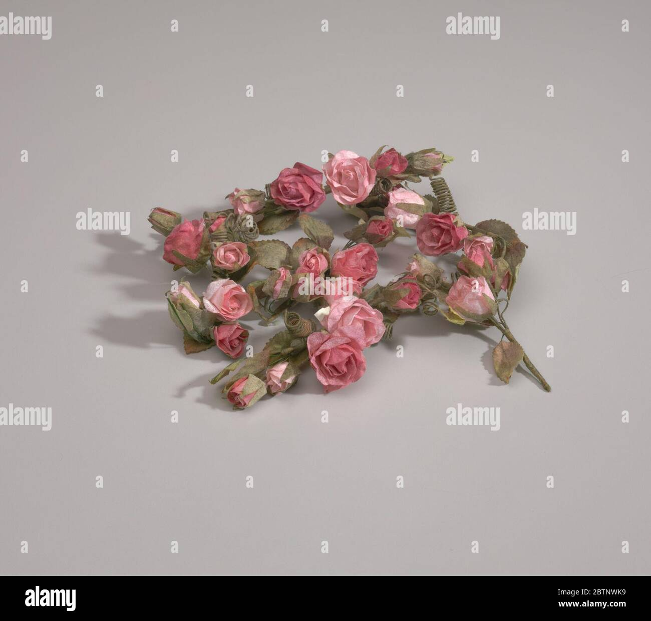 Artificial Pink Flowers From Maes Millinery Shop Artificial Pink Paper Flowers On Green Plastic Stems With Coiled Paper Wrapped Wire Pieces Coming Off The Stems The Flowers Are Tied With String To The