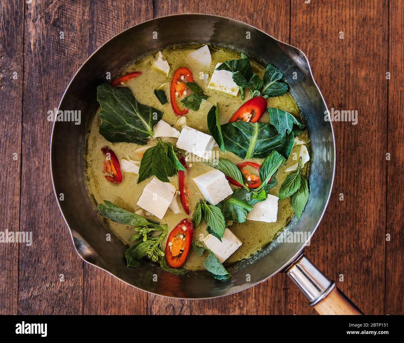 Thai green curry with tofu and vegetables being prepared Stock ...