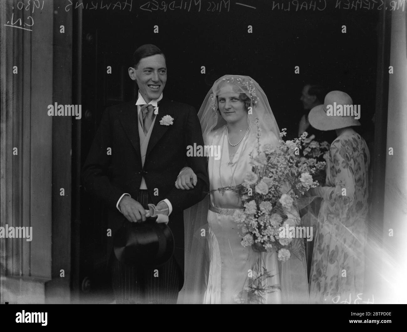 Society wedding in London . The wedding of Mr Stephen Chaplin to Miss Mildred Hawkins at St Peter ' s Church , Eaton Square , London . 10 July 1930 Stock Photo