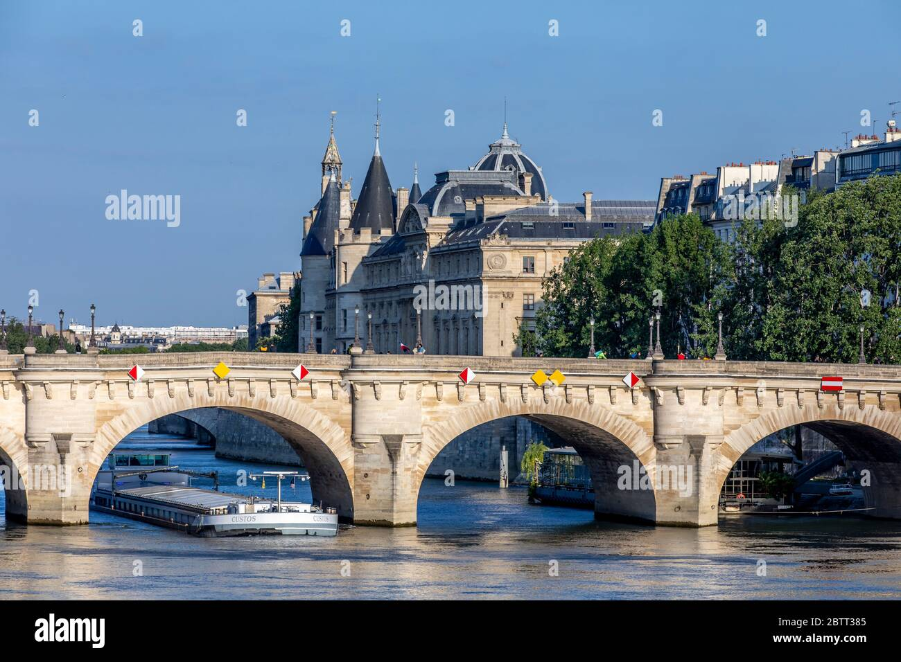 Paris, France - May 14, 2020: View of Pont neuf bridge, oldest bridge in Paris and Conciergerie in background Stock Photo