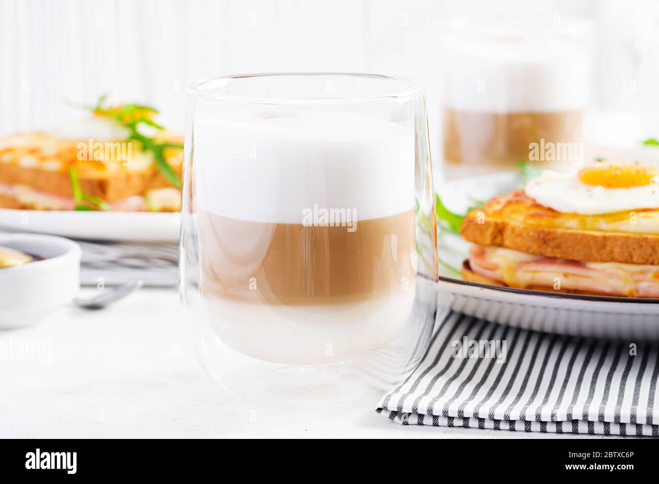 Coffee Cafe Latte Macchiato In A Glass On Light Background