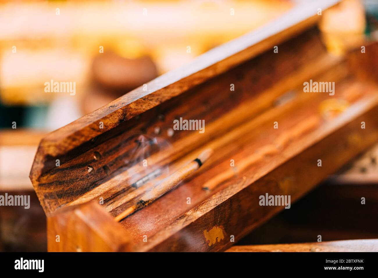 Smoking Burning Incense Aromatic Sticks In Wooden Box Releases Fragrant Smoke Incense Is Used For Aesthetic Reasons Aromatherapy Meditation And Ce Stock Photo Alamy