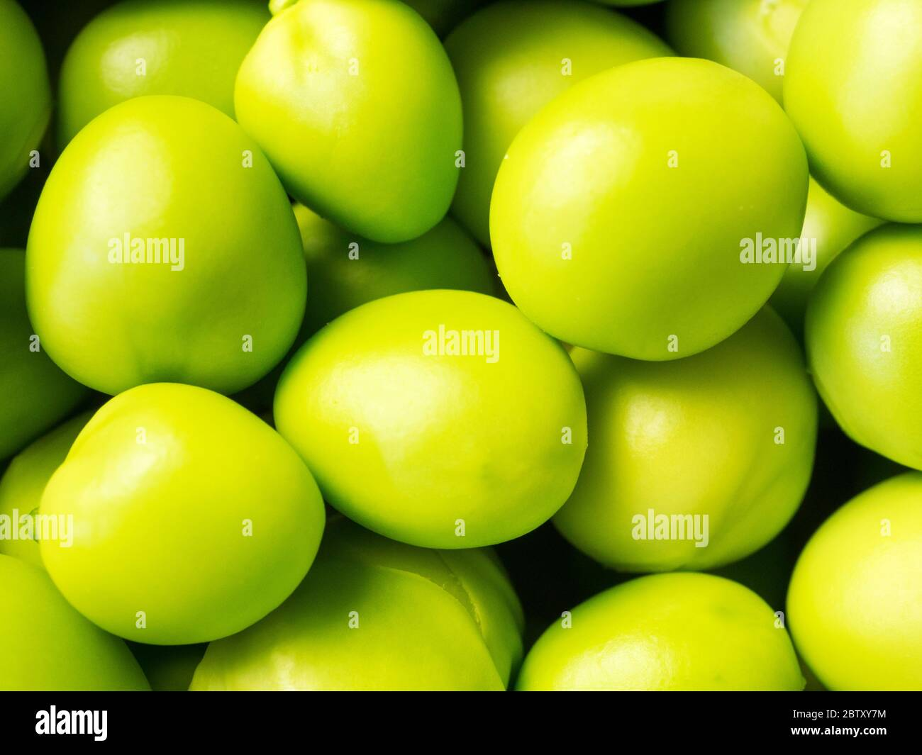 Close up of freshly shelled garden peas Stock Photo