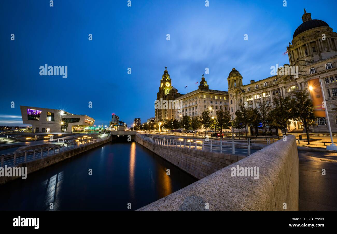 Pier Head and the Three Graces on the River Mersey Waterfront during blue hour, UNESCO World Heritage Site, Liverpool, Merseyside, England, United Kin Stock Photo